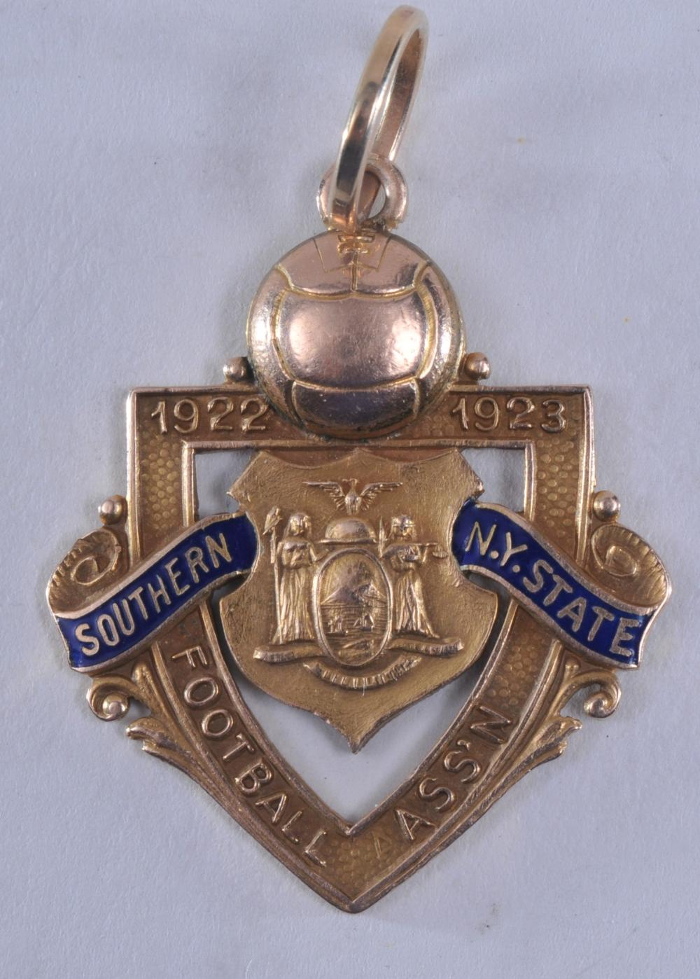 """Lot 315: 1922-23 Southern NY State Football Assoc. medal. Marked Nat'l Insignia Co. 10K. 1"""" x 1-1/4"""". 8 grams."""