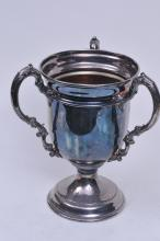 "Lot 279: Large silver-plate three-handled trophy. Sept. 17, 1932. ""Hotel Jefferson Trophy at Fairmont"". 14"" high. Good condition."