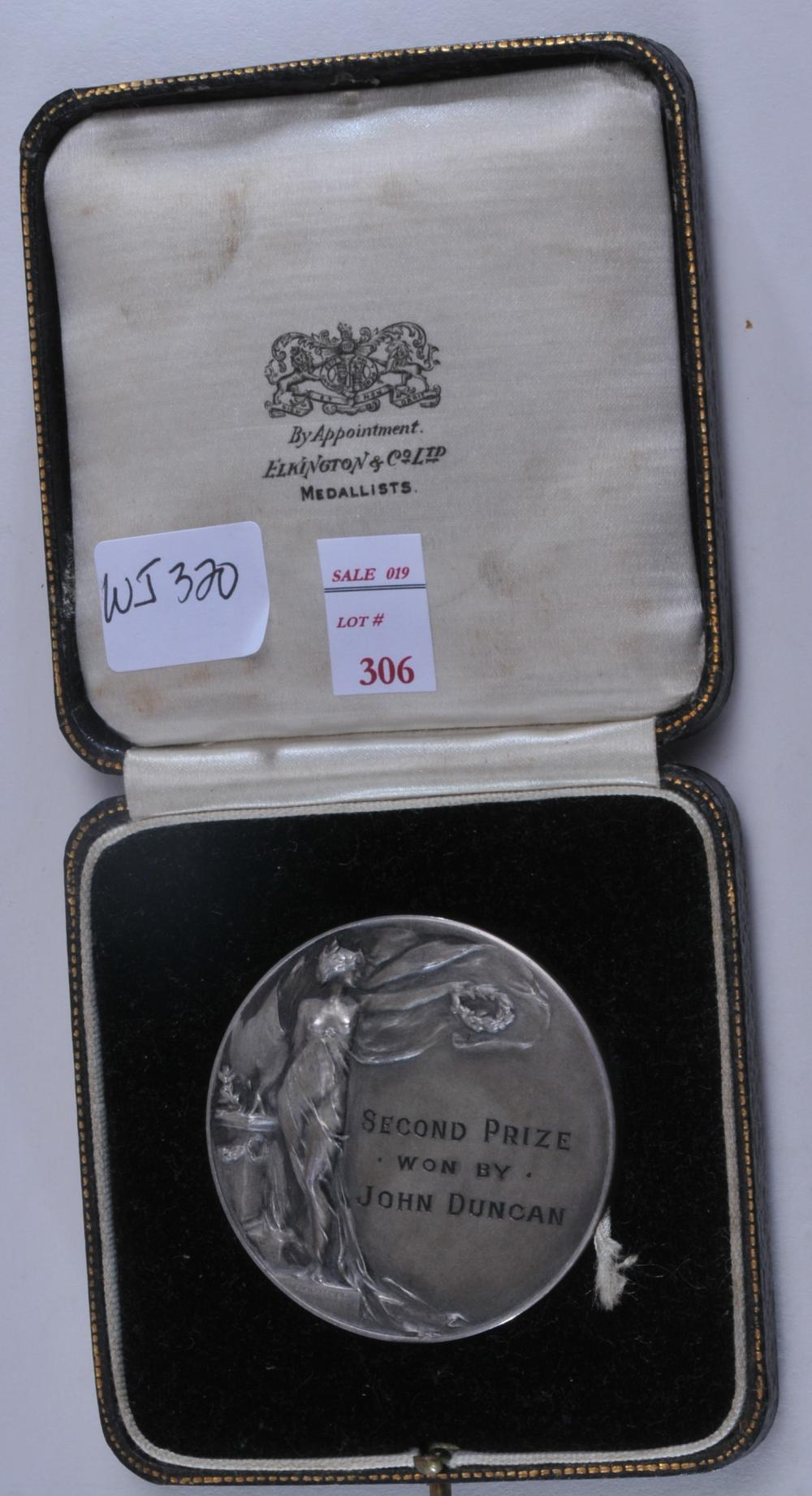 """Lot 306: 1932 silver Scottish Boxing Medal in case. Engraved """"2nd Prize won by John Duncan"""". On reverse- """"Scottish Heavyweight Speed Championship 1932"""". Marked Silver. 2"""" diameter. 1.8 ozt."""