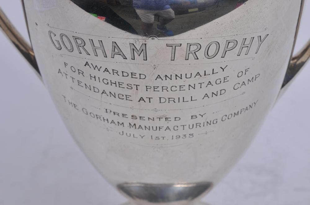 """Lot 290: Gorham sterling silver two handled trophy. """"Gorham Trophy Awarded Annually for Highest Percentage of Attendance at Drill and Camp. July 1, 1938. Won by Batter D. 243rd Coast Artillery"""". Presented by The Gorham Manufacturing Company. Slightly leaning."""