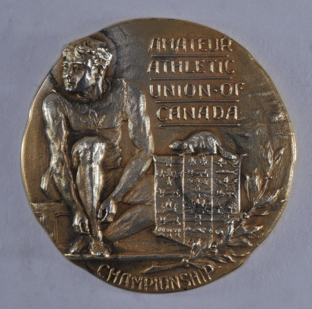 """Lot 328: Amateur Athletic Union of Canada. Championship 1912 Running High Jump First Place medal. (No name engraved). Marked Birks 10K. 1-3/4"""" diameter. 23.7 grams."""