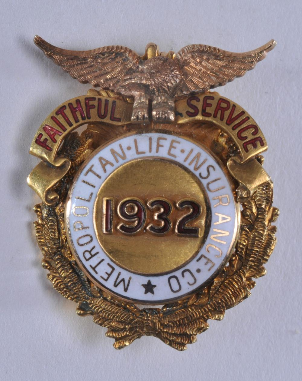 "Lot 326: 1932 Metropolitan Life Insurance pin. ""Faithful Service"". Engraved on back. Marked RS 14K. 1"" x 7/8"". 11.7 grams."