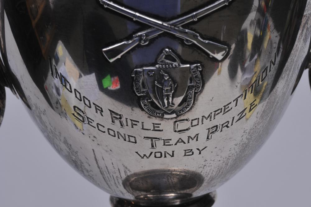 """Lot 292: Sterling silver two handled trophy. """"Commonwealth of Mass. Mass. National Guard Indoor Rifle Competition. Second Team Prize"""". Raised Rifle and Mass. Seal decoration. 11-1/2"""" high. Good condition. 20.7 ozt."""