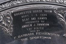 "Lot 304: Sterling silver round presentation plate. ""Rochester Horse Show. Sept. 1-6 1930. 1st Prize won by F. Barbara Feigenspan. The Sportsman"". 10"" diameter. 10.2 ozt."