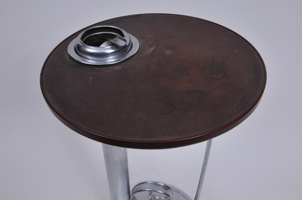 """Lot 352: Art Deco Chrome and resin ashtray stand. Removable cigarette butt container. 21"""" tall. 11"""" wide diameter of top. Stains to top. Scratches to chrome finish."""