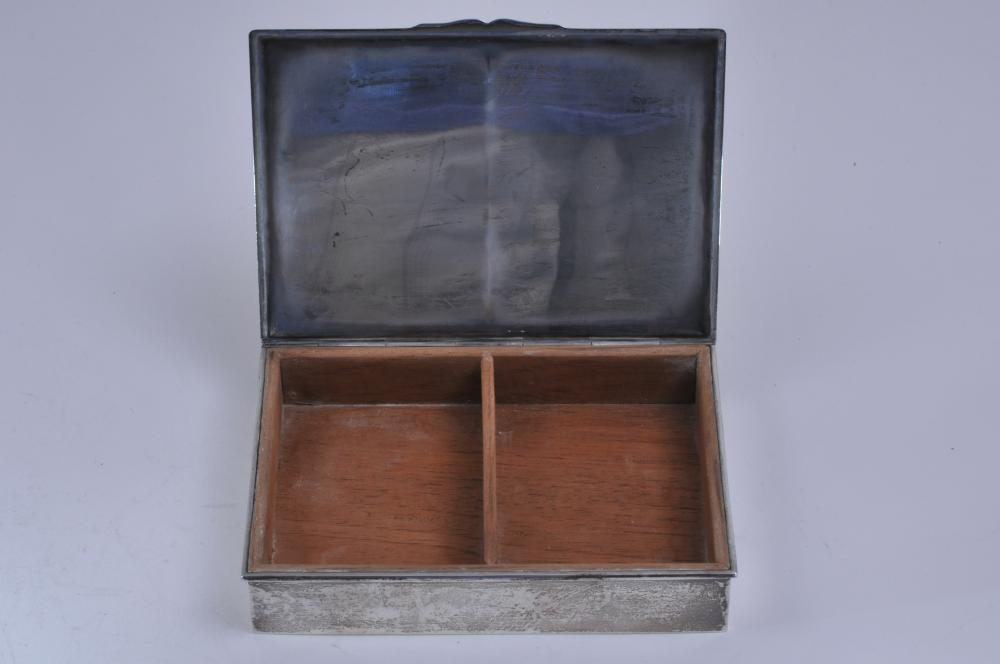 """Lot 311: 1952 Skating Club of Boston sterling silver box. Engraved on front """"To Co-Chairmen Ice Chips of 1952"""". 6-1/2"""" x 4-1/2"""". Wood interior. Marked Sterling 216 Shreve Crump Low Co. 12.6 ozt. Total weight including wood interior."""