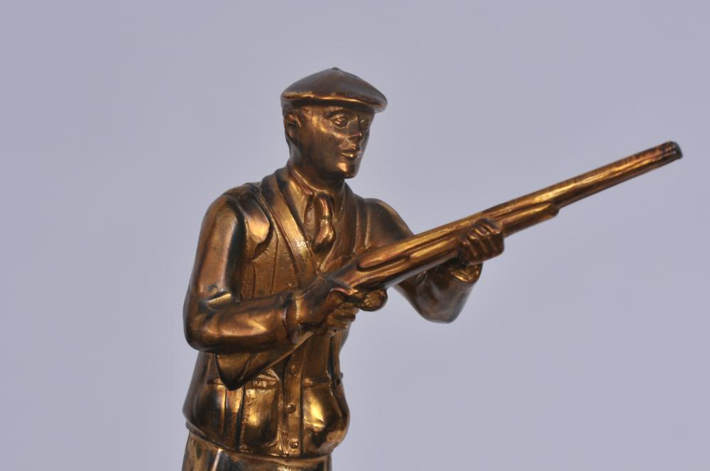 "Lot 296: Vintage Mid 20th century shooting trophy. :IBM Country Club Thomas J. Watson 1940 Class B 1st Place"". Figural shooter holding a rifle. Plastic base. 12-1/2"" high."