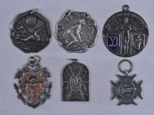 "Lot 333: Lot of six sporting medals. (1) 1912 Troy High Athletic Meet Mile Run. Engraved on back. Marked Tappins Troy Sterling. 1-1/2"" diameter. (2) 1925 1/4 mile Ladies Novice Skating medal. Marked Sterling Dieges & Clust. 1-1/4"" diameter. (3) 1926 Camp 880"