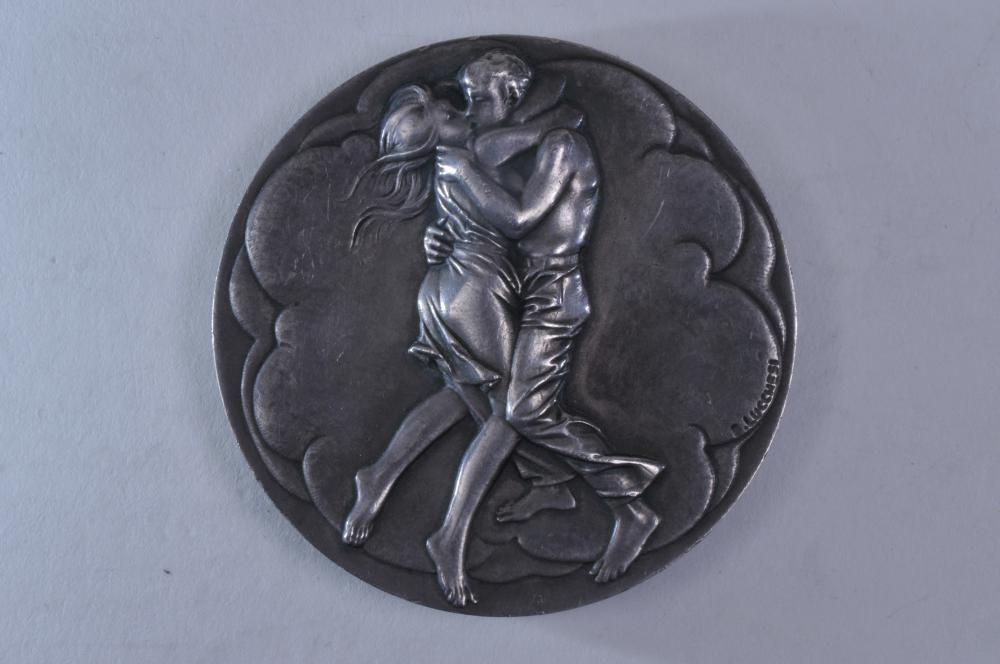 "Lot 313: Silver Medal. Couple Embracing and Mother and Baby on reverse. Signed Bruno Lucchesi, 1975. Marked on rim ""The Society of Medalists. 92nd Issue. October 1975"". .999 silver. 2-3/4"" diameter. 11.3 ozt."