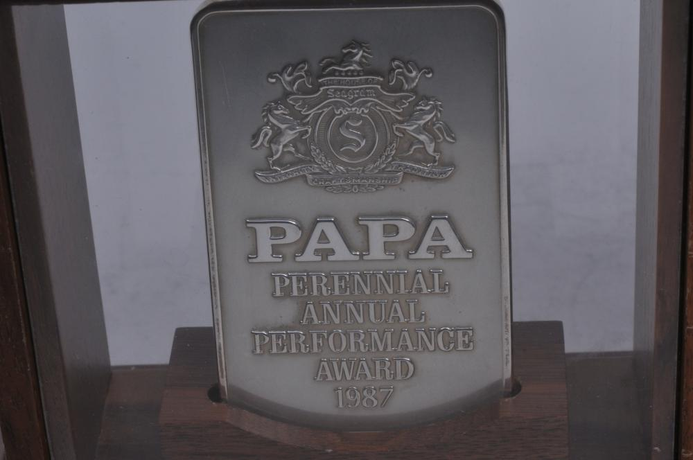 """Lot 295: Three Tiffany & Co. sterling silver presentation ingots mounted and framed. """"Beverage Companies"""". Papa Perennial Annual Performance Award 1987"""". Calvert Extra-Burnett's Gin-Coastal Beverage-Lord Calvert Canadian"""". One ingot loose, weighs 8.6 ozt. App"""