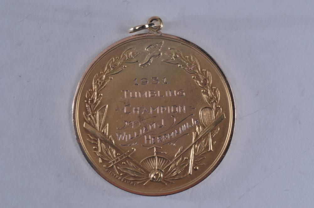 "Lot 322: 1931 Tumbling Champion medal awarded by The Amateur Athletic Union of The United States. Marked Dieges & Clust and 10k near clasp. 1-3/4"" diameter. 30 grams."