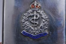 """Lot 317: Lot of four sterling silver cigarette cases. (1) Canadian Medical Corps insignia. Marked Saqui & Lawrence, Piccadilly Circus. 3-1/2"""" x 2-1/2"""". (2) Sterling & 14 karat Tiffany & Co. Engraved HSM C. Engraved. 4-1/2"""" x 3"""". (3) Sterling case, engraved RK"""