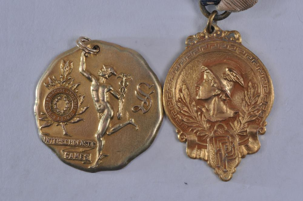 """Lot 310: Lot of two medals. (1) Syracuse U. Interscholastic Games Half Mile Run. Marked Allen Kerr. Gold filled. 1-3/8"""" diameter. 15.4 grams. (2) Medal with Ribbon of Mercury, PP and Director. Marked Dieges & Clust."""