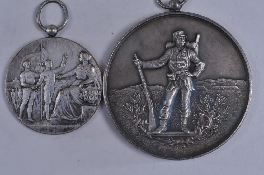 """Lot 330: Lot of four WWI silver medals. (1) Standing soldier. Engraved in French on back. 2-1/8"""" diameter. 4.8 ozt. (2) 1918 medal presented by """"The New York Athletic Club to its members who served in the World War."""" 2-1/2"""" diameter. Signed Robert Stoll. 1.9"""