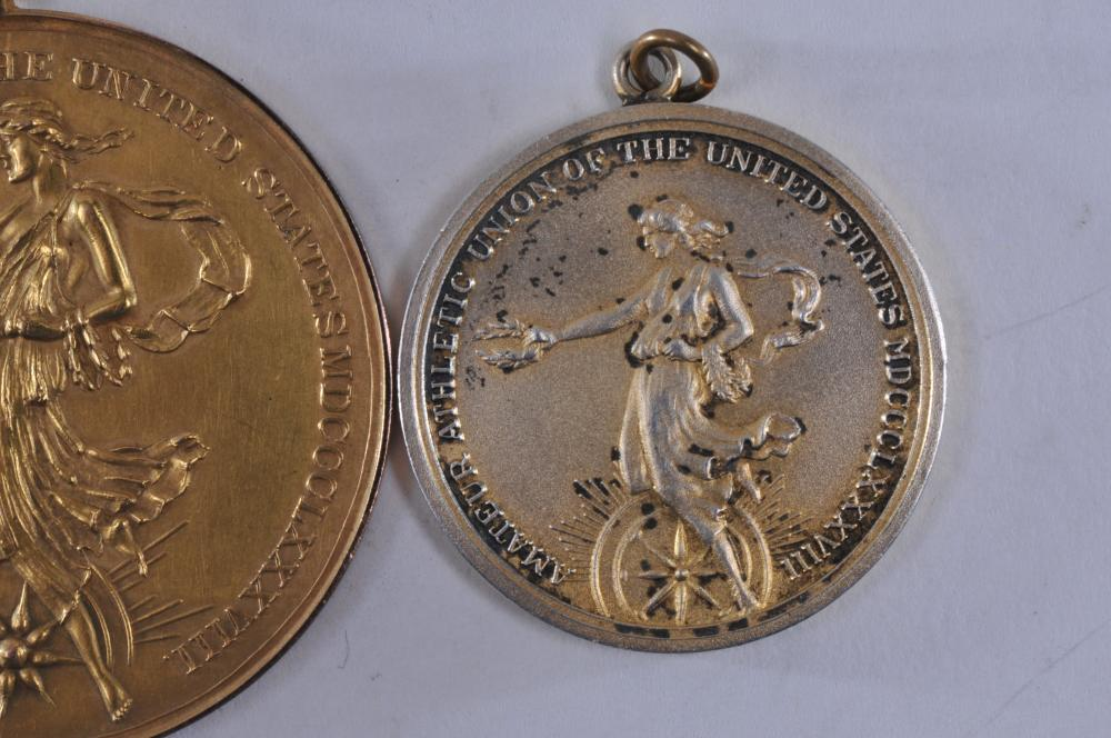 Lot 318: Lot of two medals. (1) 1921 220 Yard Hurdle medal awarded by the Amateur Athletic Union of The United States. Marked T.V. Allen Co. LA CA. 32.8 grams. Tested as 14 karat gold. 32.9 grams. (2) 1957 30 Kilo medal awarded by The Amateur Athletic Union o