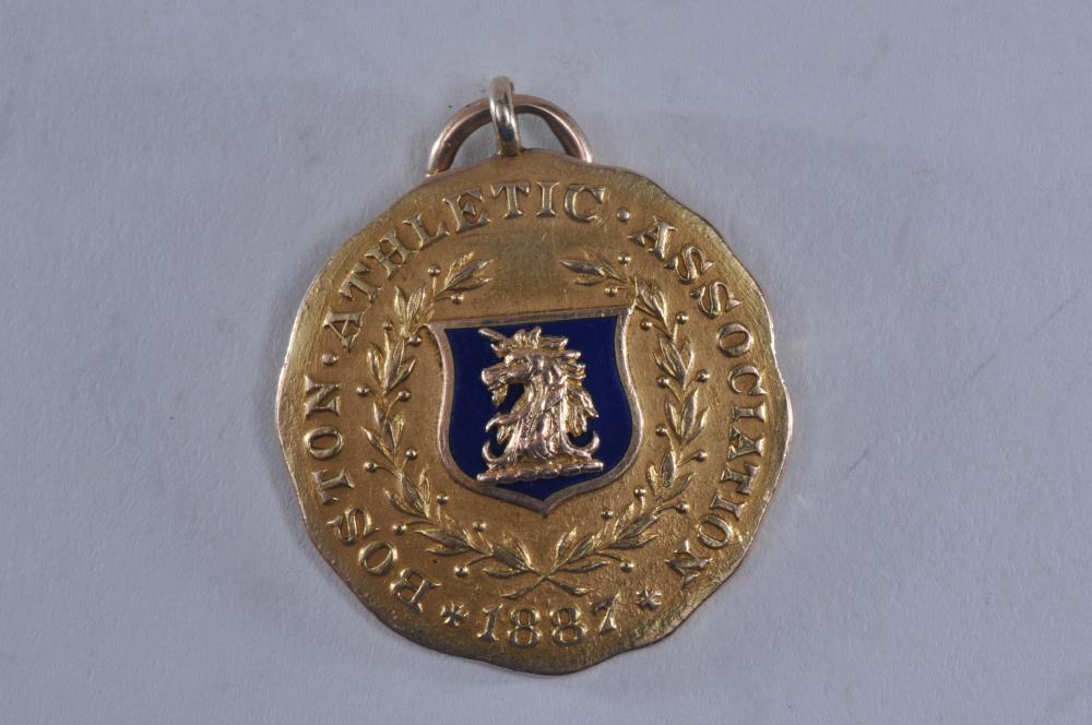 """Lot 319: 1912 Boston Athletic Association gold High Jump medal. Marked Solid Gold Dieges & Clust Boston. 1-1/4"""" diameter. 16.5 grams. No name engraved. Tested as 14 karat gold."""