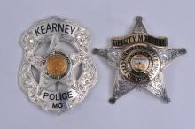 Lot 338: Two sterling silver limited edition law badges. (1) Kearney Police Star badge. Lawman Badge Co. 12/400. (2) City of Tombstone Deputy Marshall Star badge. Lawman Badge Co. #171.