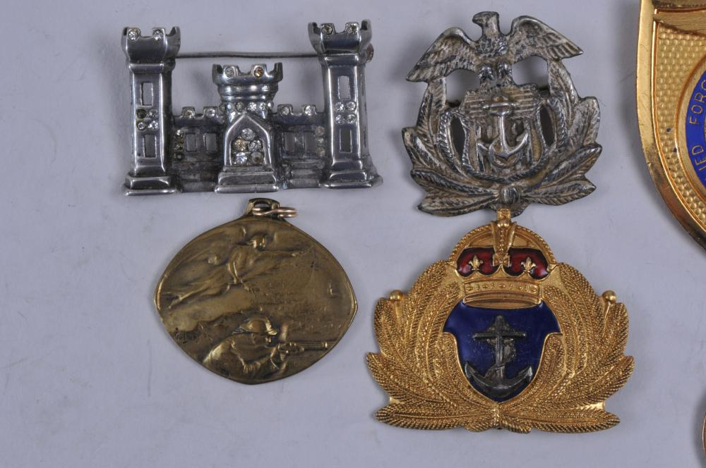 Lot 344: Lot of seven medals and badges. (1) 1973 Twin Cities shooting medal. (2) Allied Forces Mediterranean badge. (3) Sterling silver Engineers pin. (4) Badge with foliage, anchor and crown. (5) Airborne Ranger Badge. 10 Karat gold. (6) WWI medal with sold