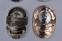Lot 336: Lot of six limited edition Law Enforcement badges. (1) East Syracuse Police badge, #20/300. (2) Gettysburg Police Badge. #107/300. (3) New Orleans Police Super Bowl XXX1 Badge #1209. (40 Gun Barrel City Police Badge 7/300. (5) Pelican Bay Police Chie