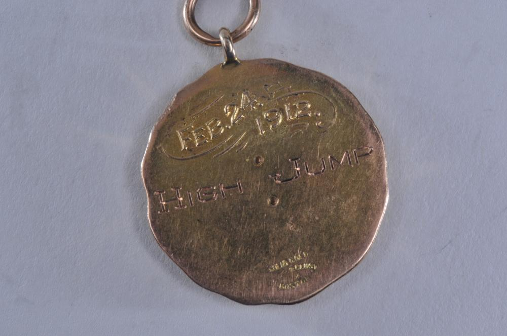 "Lot 319: 1912 Boston Athletic Association gold High Jump medal. Marked Solid Gold Dieges & Clust Boston. 1-1/4"" diameter. 16.5 grams. No name engraved. Tested as 14 karat gold."