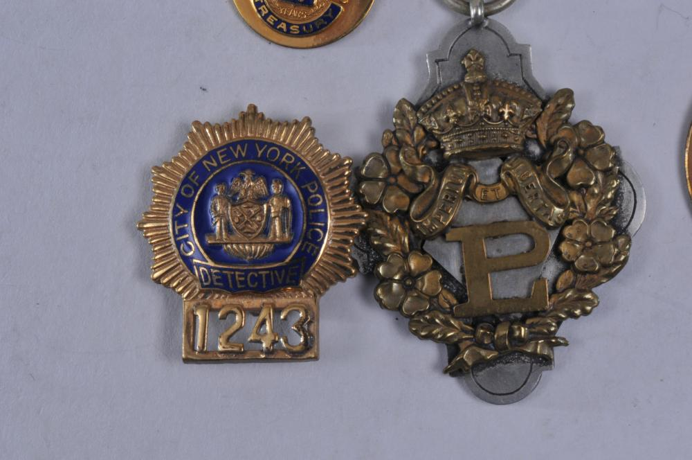 Lot 347: Lot of nine medals and badges. (1) Mass. Grand Lodge medal. (2) 1967 N.H. Numismatic medal. (3) Sterling silver Fraternal medal. (4) Boston Post Office badge. (5) Boston Chamber of Commerce, 1919. (6) City of New York Police Detective badge. (7) Gold