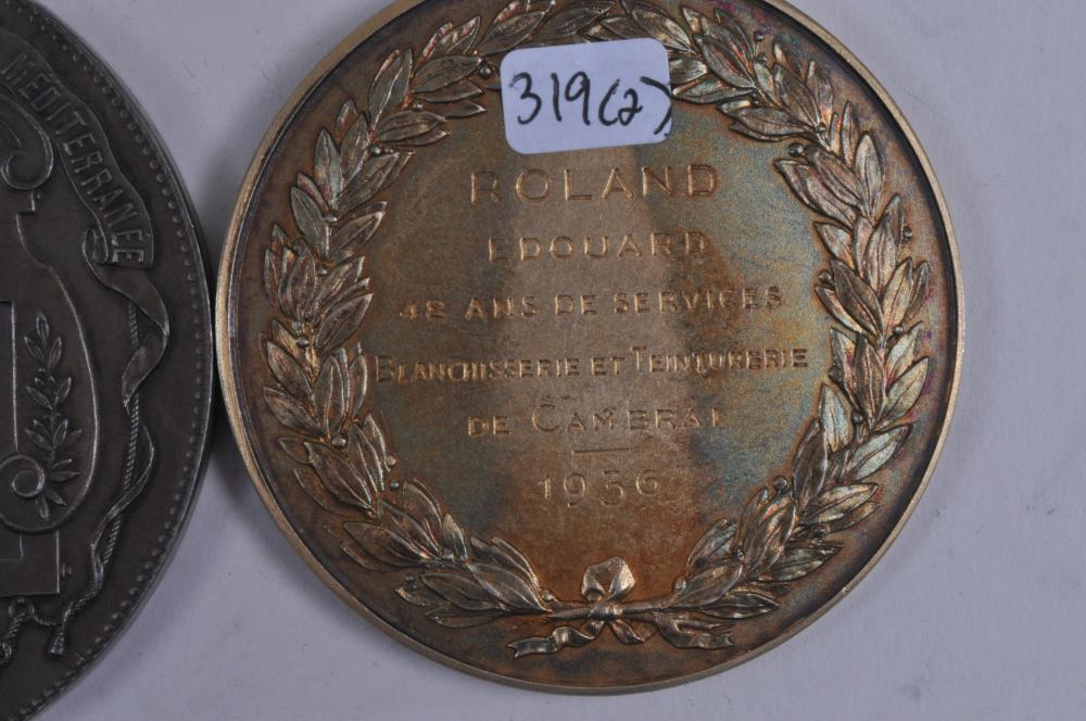 """Lot 341: Lot of two medals. (1) 1936 Medal. Societe Industriale St. Quentin. Engraved on back. Marked Argent on rim. 2-1/4"""" diameter. 3.1 ozt. (2) Compagnie Generale Transatlantique medal. 1952. Engraved and signed Pagnier. Marked Argent on rim. 2-3/4"""" diame"""