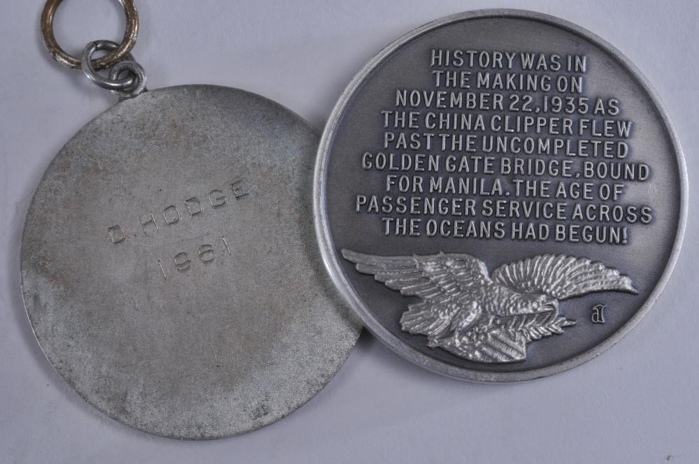 """Lot 343: Lot of six silver medals. (1) China Clipper 1935 medal commerating Flight over Golden Gate bridge. Signed JDL. 1-1/2"""" diameter. """"Longines Symphonnette Sterling"""" on rim. (2)Two Miss America Pageant medals dated 1957 & 58. Engraved on back. Both marked"""