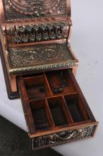 "Lot 349: Heavy brass National Cash Register Co. Antique cash register. Model 311. Relief filigree decorated sides. Serial Number: 734992. Functional keys, door opens. Missing top. ""Amount Purchased sign. No Key. 9-1/2""deep. 15-1/2"" wide. 17"" tall."