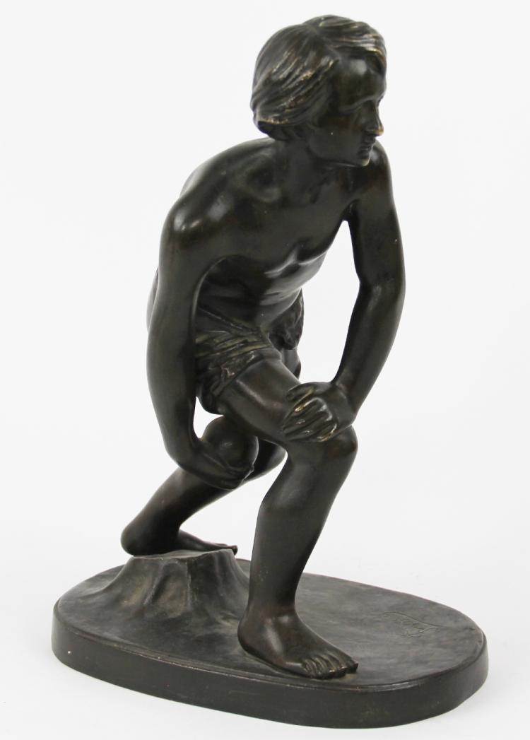 Bartelemy Frison (French, 1816-1877) The Boules Player, bronze figure of a boy in boules playing stance, raised on oval base, signed 'Frison' below the right leg, dark brown patination, 32cm high
