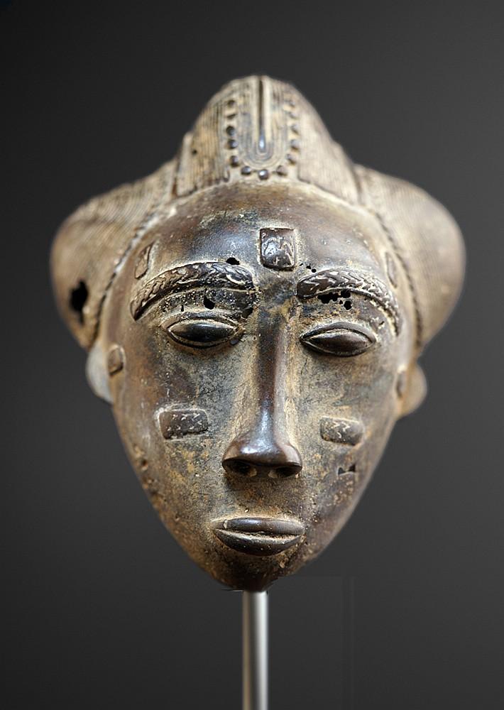 A small Baule bronze head