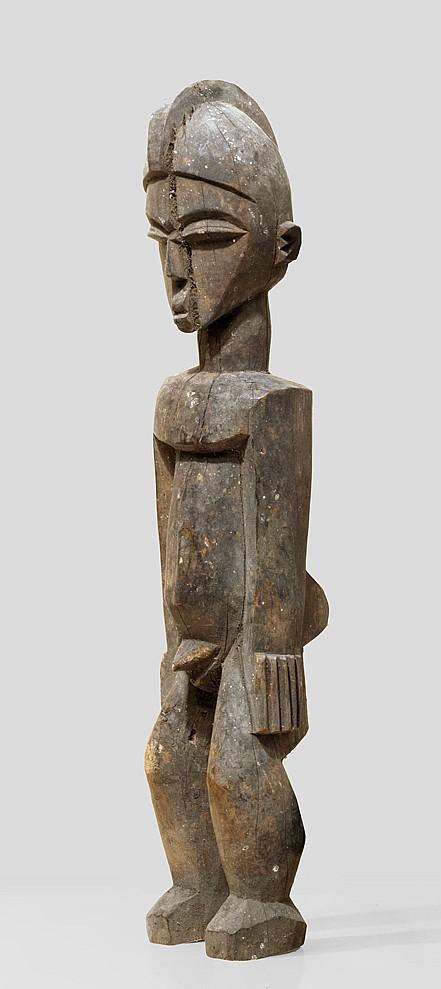 A sculpture of the Kampti carvers