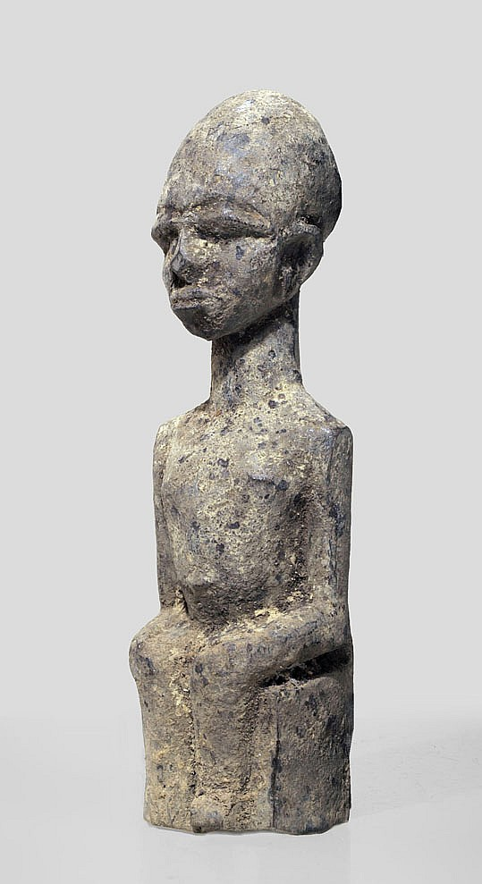 A Lobi sculpture in seated position