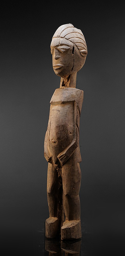 A well know, unidentified Lobi carver