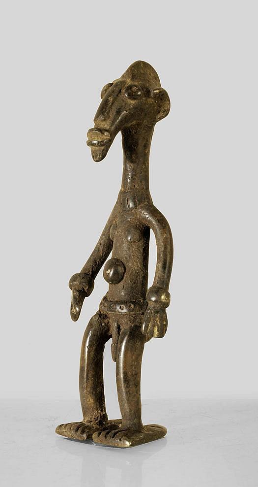 A Senoufo bronze sculpture