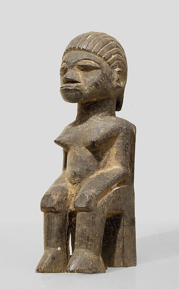 A seated Lobi sculpture