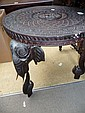 A Indian hardwood carved circular low table with