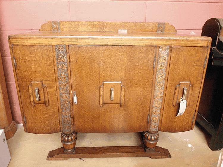An Art Deco oak side board ca 1935 of small