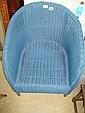 A Lloyd Loom style blue painted armchair