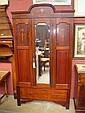 An Edwardian inlaid mahogany wardrobe