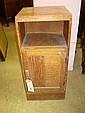 An early 20th century oak bedside cupboard