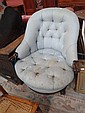 A late Victorian buttonback armchair with carved