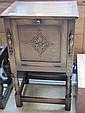 A 1930s oak fall front bedside cabinet