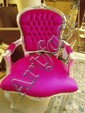 A very silver and pink open armchair