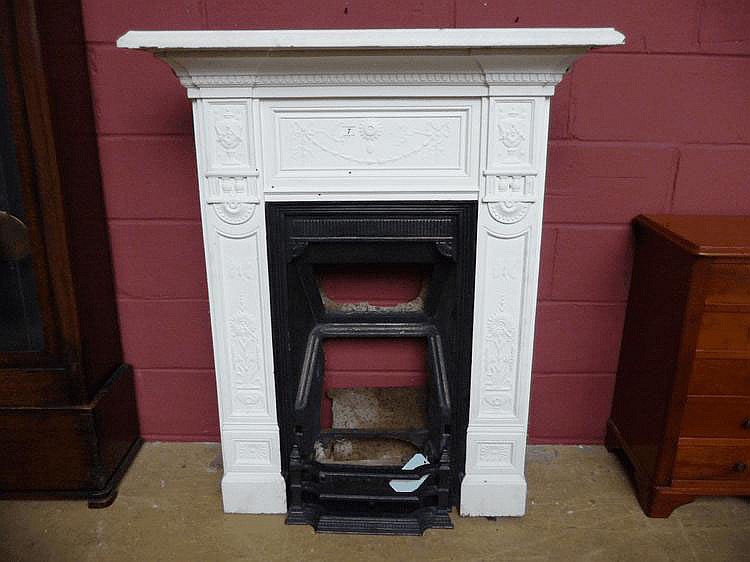 An Edwardian white painted cast iron chimney piece