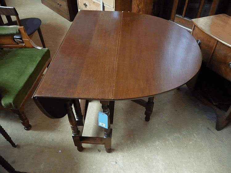 A 1930's oak gateleg table