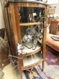 An Edwardian mahogany bow fronted display cabinet