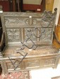 Early 20thC carved oak settle with 17thC elements