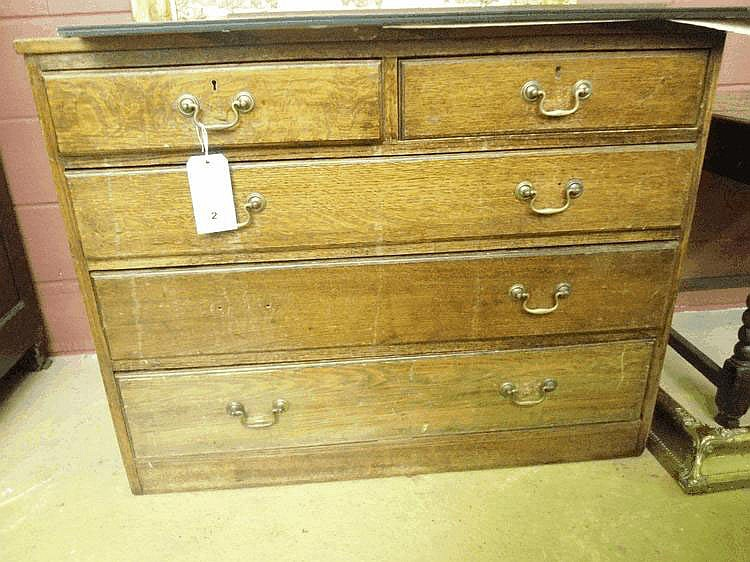 An early 20th century oak chest of drawers, two