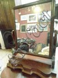 A mid Victorian mahogany swing toilet mirror