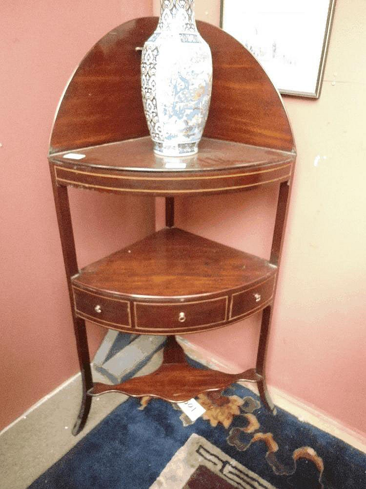 A George III mahogany corner washstand together